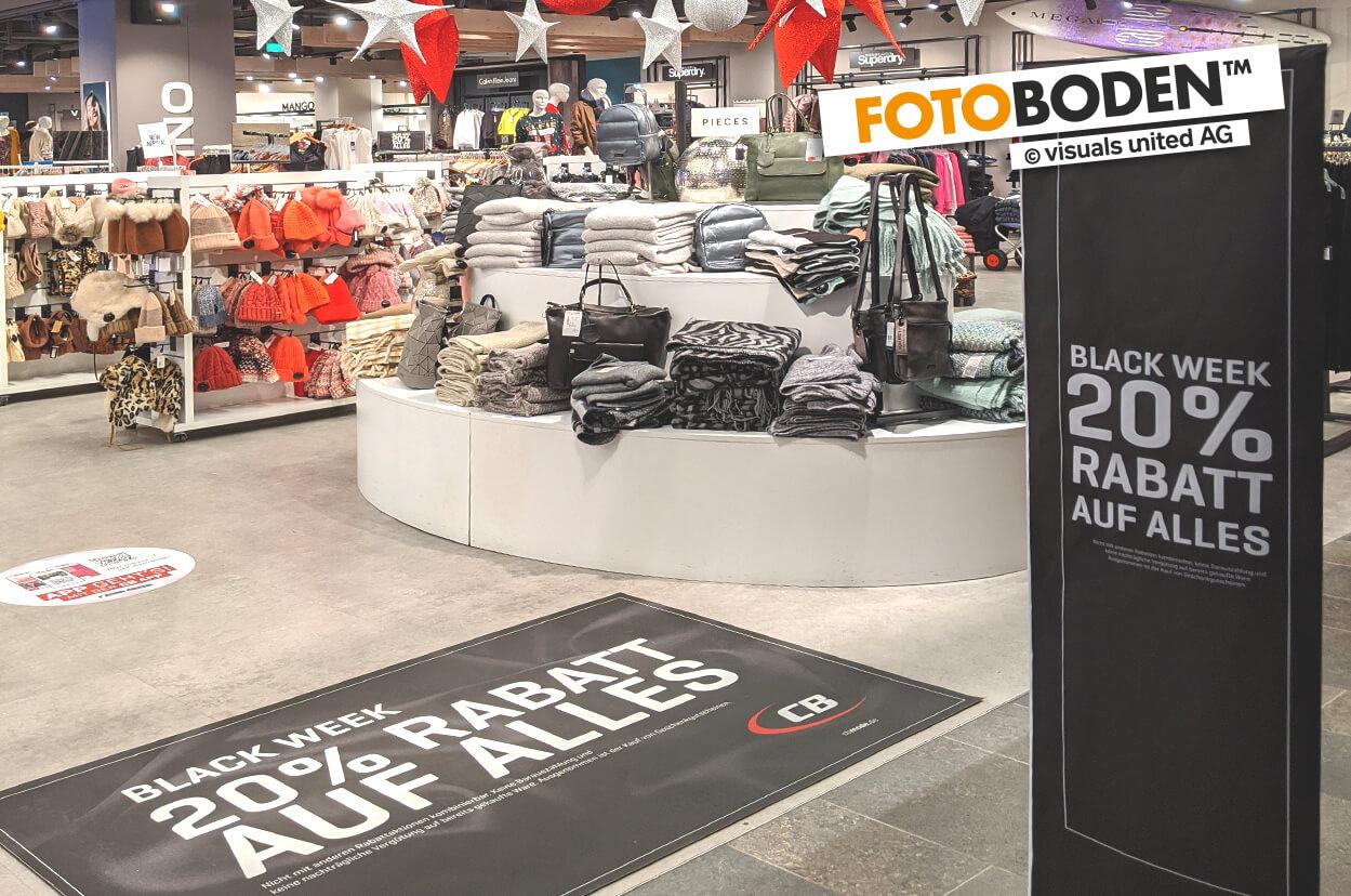 POS Werbematte. 20% zur Black Week - Bodenwerbung mit FOTOBODEN™